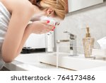 attractive woman to wash in... | Shutterstock . vector #764173486