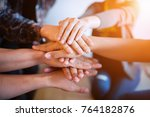 teamwork putting their hands... | Shutterstock . vector #764182876