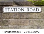 Road Sign On A Brick Wall...