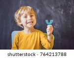 three year old boy shows... | Shutterstock . vector #764213788