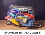 packed suitcase with travel... | Shutterstock . vector #764220055