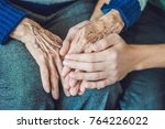hands of an old woman and a... | Shutterstock . vector #764226022