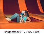 mother and her son jumping on a ...   Shutterstock . vector #764227126