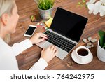 woman working with laptop...   Shutterstock . vector #764242975