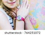 girl with her kid's watch | Shutterstock . vector #764251072