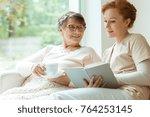 happy elder woman sitting on... | Shutterstock . vector #764253145