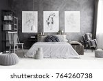 pouf and boxes near grey chair... | Shutterstock . vector #764260738