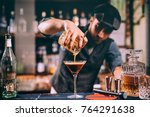Stock photo vintage portrait of bartender creating cocktails at bar close up of alcoholic beverage preparation 764291638
