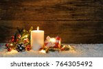 christmas gift box with burning ... | Shutterstock . vector #764305492
