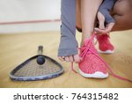 female squash player tying... | Shutterstock . vector #764315482