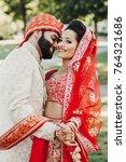 indian groom dressed in white... | Shutterstock . vector #764321686