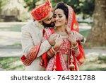 indian groom dressed in white...   Shutterstock . vector #764321788