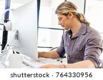 handsome businessman working at ... | Shutterstock . vector #764330956