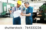 engineer teaching apprentices... | Shutterstock . vector #764333236
