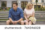 unhappy couple sitting after... | Shutterstock . vector #764346028