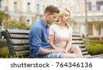 couple feeling awkward  sitting ... | Shutterstock . vector #764346136