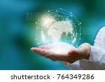 businessman holding in hand...   Shutterstock . vector #764349286