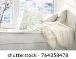 cushions and a knitted plaid on ...   Shutterstock . vector #764358478