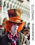 Small photo of Venice, Italy - March 6, 2011: Unidentified participant in costume Mad Hatter from Alice in Wonderland story on St. Mark's Square during the Carnival of Venice