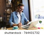 smiling young freelancer... | Shutterstock . vector #764431732