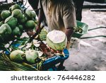 man handing in a green coconut. ... | Shutterstock . vector #764446282