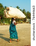 indian woman carrying a bundle... | Shutterstock . vector #76444663
