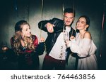 friends at the party drinking... | Shutterstock . vector #764463856