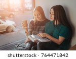 two girl s absorbed in reading... | Shutterstock . vector #764471842