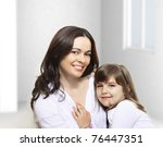 Portrait of happy mother and her smiling daughter - stock photo