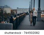 Loving Couple Are Walkihg In...