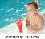 little girl in the swimming...