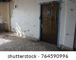 door in interior of abandoned...   Shutterstock . vector #764590996