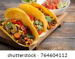 three mexican tacos with minced ... | Shutterstock . vector #764604112