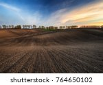 hilly field. beautiful sky over ... | Shutterstock . vector #764650102