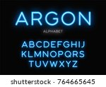 glowing neon typeface design.... | Shutterstock .eps vector #764665645