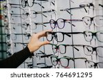 stand with glasses in the store ... | Shutterstock . vector #764691295