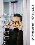 beautiful girl wearing glasses... | Shutterstock . vector #764691316