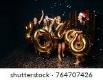 happy women in santa hats... | Shutterstock . vector #764707426