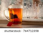 a tea bag in a mug. a mug of... | Shutterstock . vector #764712358
