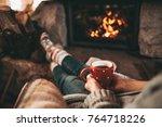 woman in woollen socks by the... | Shutterstock . vector #764718226