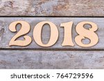 cutout wooden number 2018 on... | Shutterstock . vector #764729596