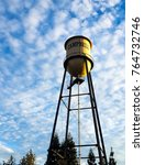 Water Tower Against A Blue Sky...