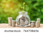 growth sprout plant in saving... | Shutterstock . vector #764738656