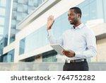 happy black businessman with... | Shutterstock . vector #764752282