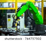 close up robot hands in milling ... | Shutterstock . vector #764757502