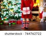child at christmas tree and... | Shutterstock . vector #764762722