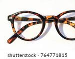 Stock photo reading glasses on a white background macro close up shot 764771815