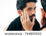 man in front of mirrror looking ...   Shutterstock . vector #764805532