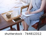 young girl  with book in... | Shutterstock . vector #764812312