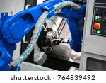 close up robot hands in milling ... | Shutterstock . vector #764839492
